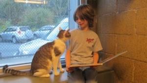 猫に子供が本を読むプログラム。